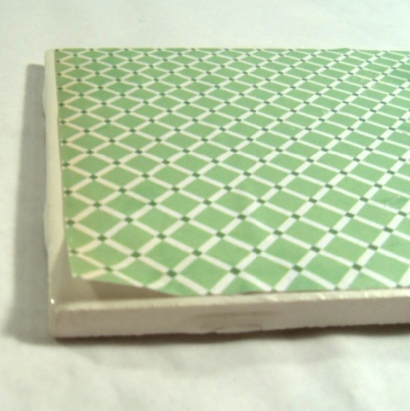 Paper lifting on tile coaster